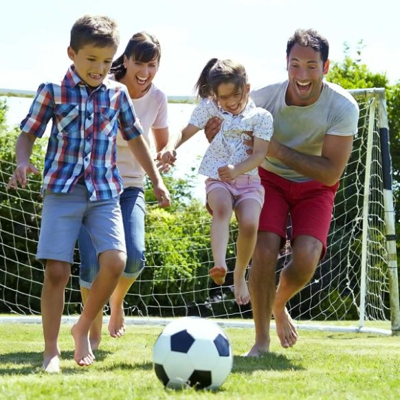 Happy Family playing in the garden with NoMOW artificial grass.
